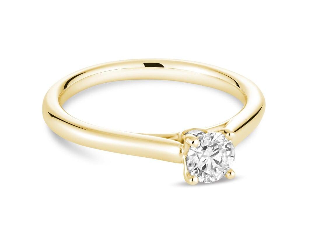 Bague de fiançailles avec 0.78 ct diamant rond brillant or jaune 14k